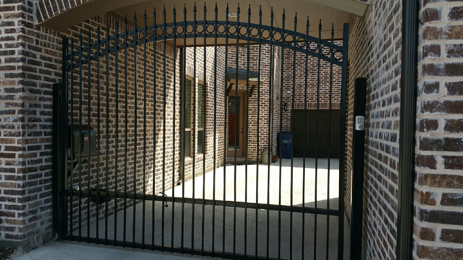 Driveway Doors Double Swing Gate With Circle Patterns Cut At An Angle To Account For The