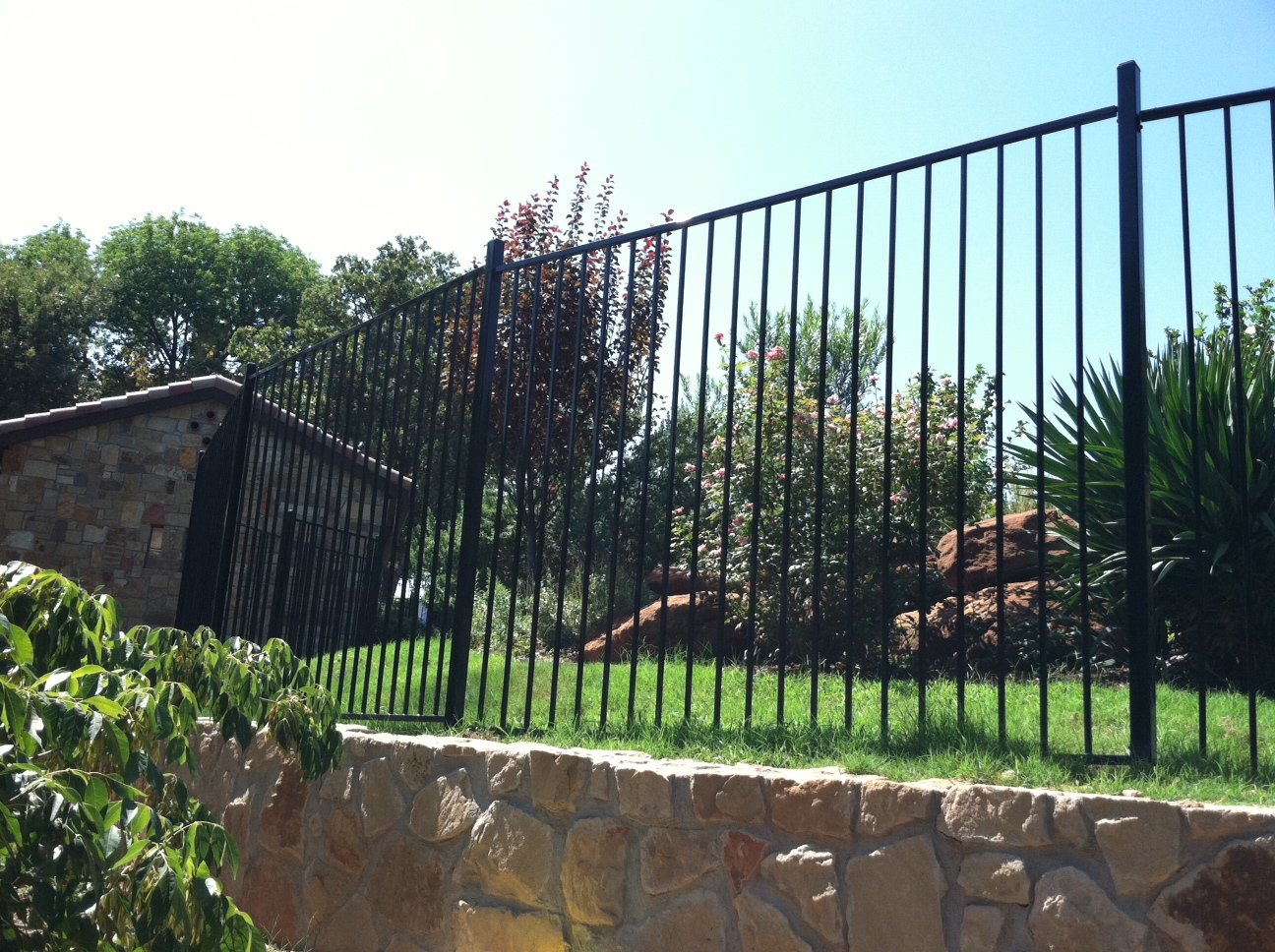 Wrought iron fences frisco tx iron handrails frisco iron pool 5 ft tall metal fence on retaining wall baanklon Images