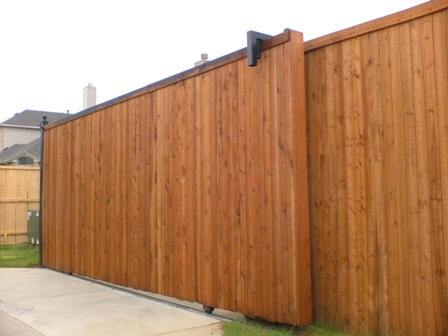 Double sliding gate ideas joy studio design gallery for Wooden sliding driveway gates