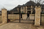 Automatic Driveway Gate w/ Stone Columns & Security Access Code