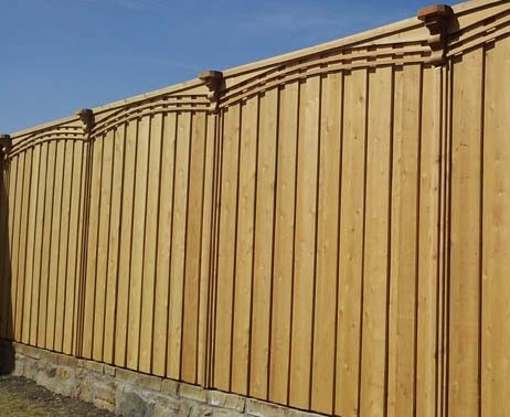wood fence with retaining wall